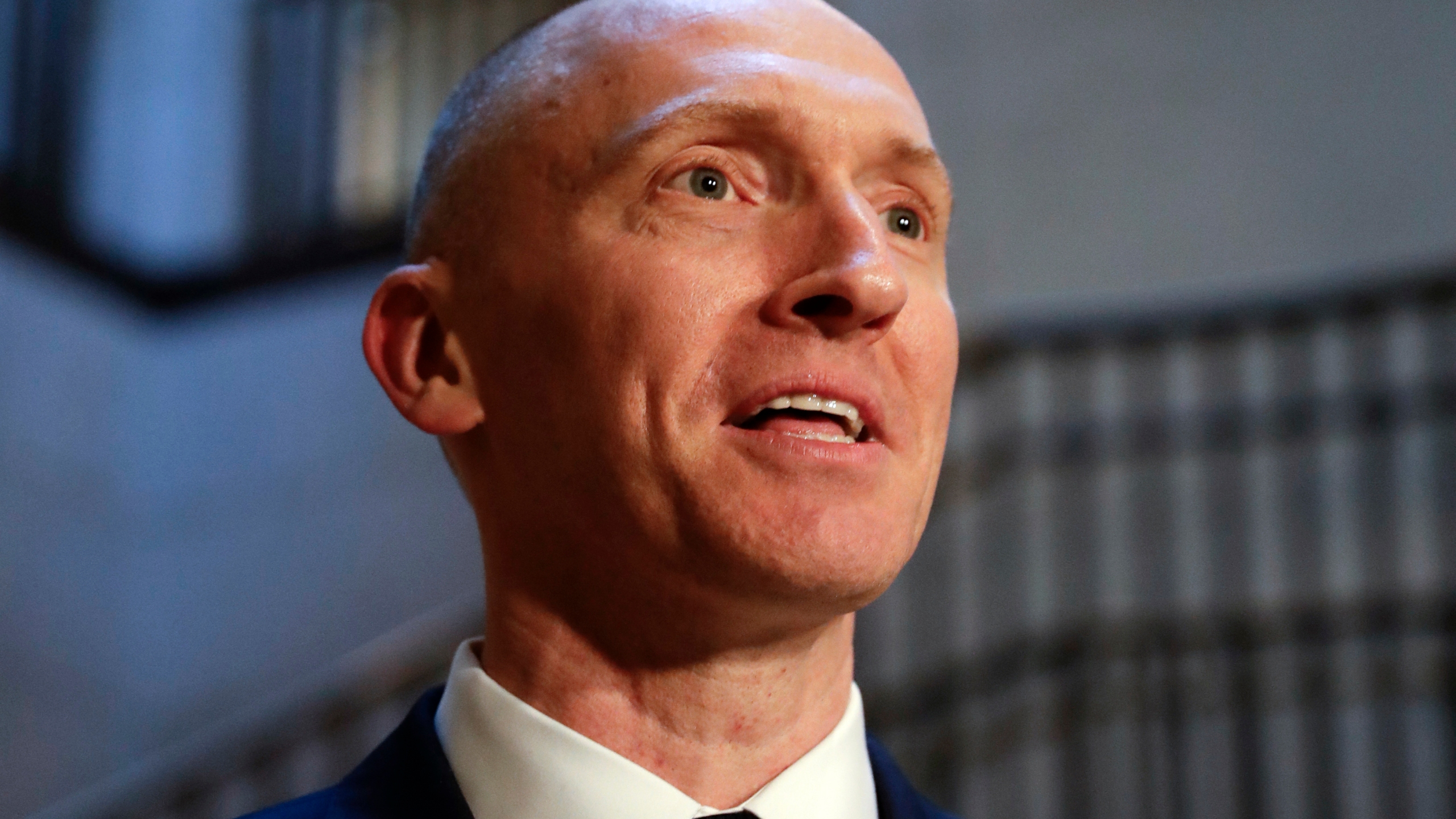 "FILE - In this Nov. 2, 2017, photo, Carter Page, a foreign policy adviser to Donald Trump's 2016 presidential campaign, speaks with reporters following a day of questions from the House Intelligence Committee, on Capitol Hill in Washington. Page, who was the target of a secret surveillance warrant during the FBI's Russia investigation says in a federal lawsuit filed Friday, Nov. 27, 2020, that he was the victim of ""unlawful spying."" The suit from Carter Page alleges a series of omissions and errors made by FBI and Justice Department officials in applications they submitted to the Foreign Intelligence Surveillance Court to eavesdrop on Page on suspicion that he was an agent of Russia.(AP Photo/J. Scott Applewhite)"