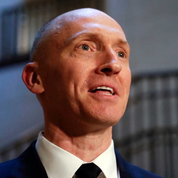 """FILE - In this Nov. 2, 2017, photo, Carter Page, a foreign policy adviser to Donald Trump's 2016 presidential campaign, speaks with reporters following a day of questions from the House Intelligence Committee, on Capitol Hill in Washington. Page, who was the target of a secret surveillance warrant during the FBI's Russia investigation says in a federal lawsuit filed Friday, Nov. 27, 2020, that he was the victim of """"unlawful spying."""" The suit from Carter Page alleges a series of omissions and errors made by FBI and Justice Department officials in applications they submitted to the Foreign Intelligence Surveillance Court to eavesdrop on Page on suspicion that he was an agent of Russia.(AP Photo/J. Scott Applewhite)"""