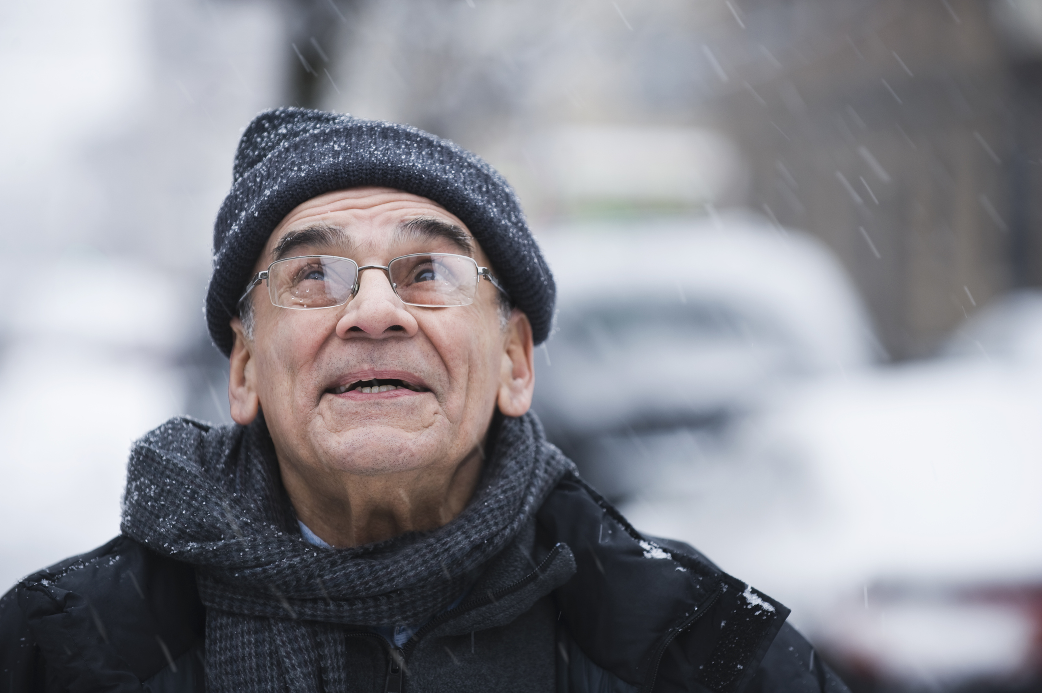 Man wearing coat in the cold, snow (Getty Images)