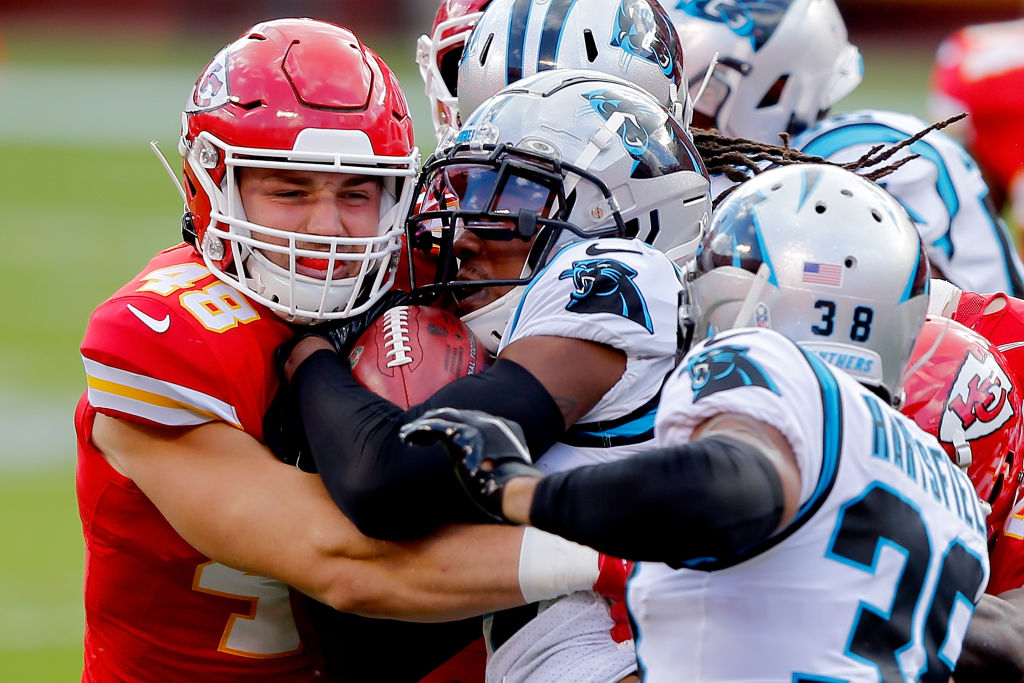 KANSAS CITY, MISSOURI - NOVEMBER 08: Nick Keizer #48 of the Kansas City Chiefs tackles Pharoh Cooper #14 of the Carolina Panthers on the opening kickoff in the first quarter at Arrowhead Stadium on November 08, 2020 in Kansas City, Missouri. (Photo by David Eulitt/Getty Images)