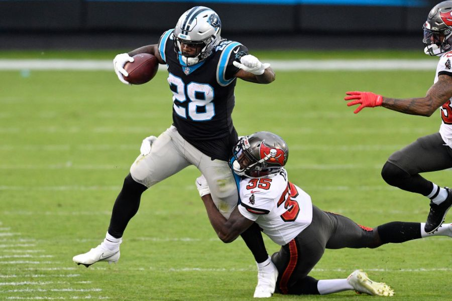 CHARLOTTE, NORTH CAROLINA - NOVEMBER 15: Mike Davis #28 of the Carolina Panthers rushes with the ball against the Tampa Bay Buccaneers during their NFL game at Bank of America Stadium on November 15, 2020 in Charlotte, North Carolina. (Photo by Grant Halverson/Getty Images)