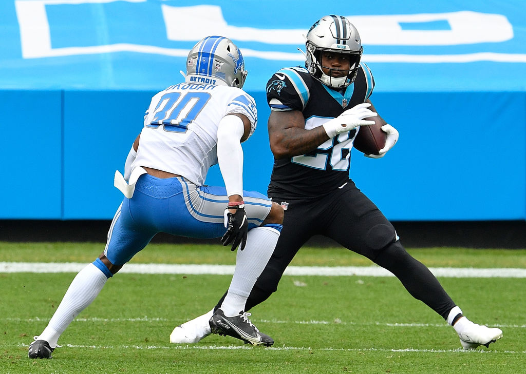 CHARLOTTE, NORTH CAROLINA - NOVEMBER 22: Mike Davis #28 of the Carolina Panthers rushes against Jeff Okudah #30 of the Detroit Lions during the first half at Bank of America Stadium on November 22, 2020 in Charlotte, North Carolina. (Photo by Grant Halverson/Getty Images)