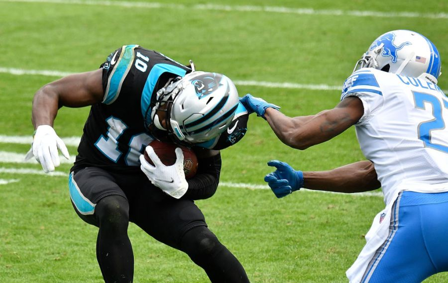 CHARLOTTE, NORTH CAROLINA - NOVEMBER 22: Curtis Samuel #10 of the Carolina Panthers attempts to break a tackle by Justin Coleman #27 of the Detroit Lions during the first half at Bank of America Stadium on November 22, 2020 in Charlotte, North Carolina. (Photo by Grant Halverson/Getty Images)