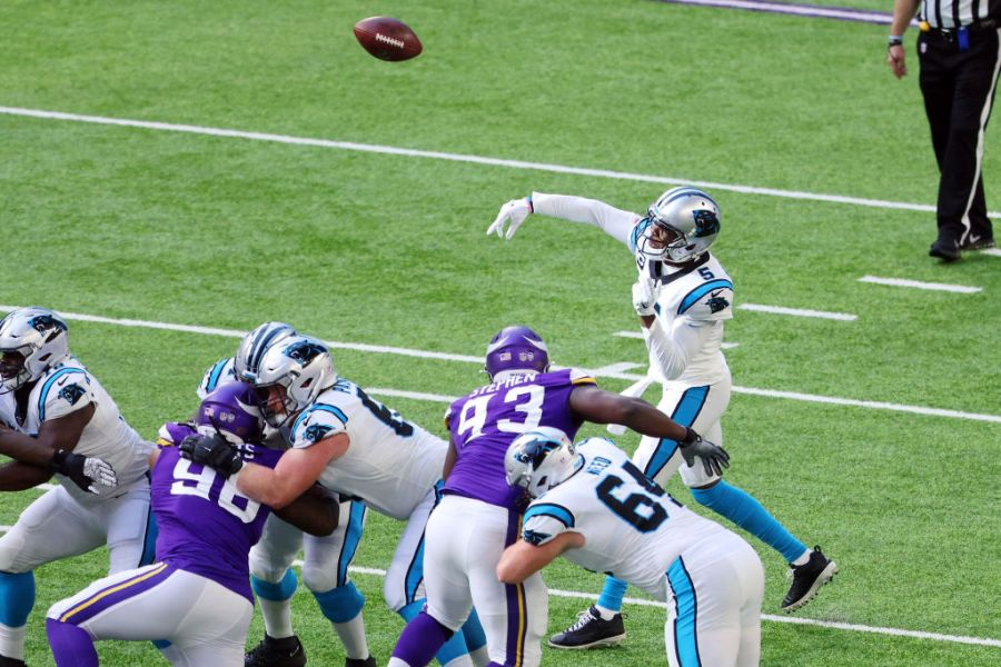 MINNEAPOLIS, MINNESOTA - NOVEMBER 29: Teddy Bridgewater #5 of the Carolina Panthers throws a pass during the first half against the Minnesota Vikings at U.S. Bank Stadium on November 29, 2020 in Minneapolis, Minnesota. (Photo by Adam Bettcher/Getty Images)