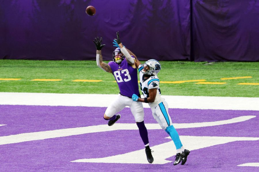 MINNEAPOLIS, MINNESOTA - NOVEMBER 29: Rasul Douglas #24 of the Carolina Panthers breaks up a touchdown pass intended for Tyler Conklin #83 of the Minnesota Vikings during the first half at U.S. Bank Stadium on November 29, 2020 in Minneapolis, Minnesota. (Photo by Adam Bettcher/Getty Images)