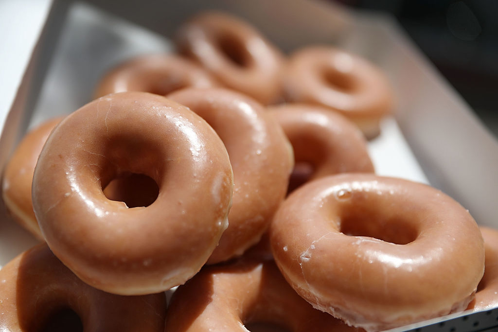 """Anyone who stops by a U.S. store can get a free glazed donut and an """"I Voted"""" sticker. (Photo illustration by Joe Raedle/Getty Images)"""