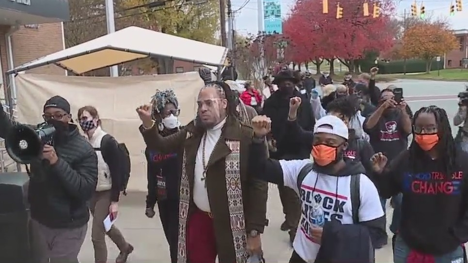 Hundreds of protesters flood Graham streets calling for reform of police, criminal justice