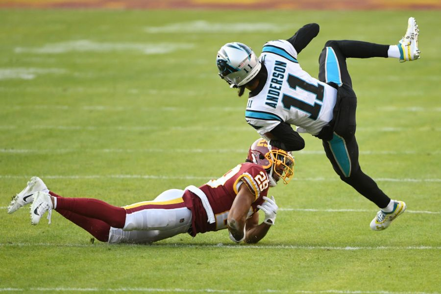 LANDOVER, MARYLAND - DECEMBER 27: Robby Anderson #11 of the Carolina Panthers attempts to break a tackle from Kendall Fuller #29 of the Washington Football Team at FedExField on December 27, 2020 in Landover, Maryland. (Photo by Will Newton/Getty Images)