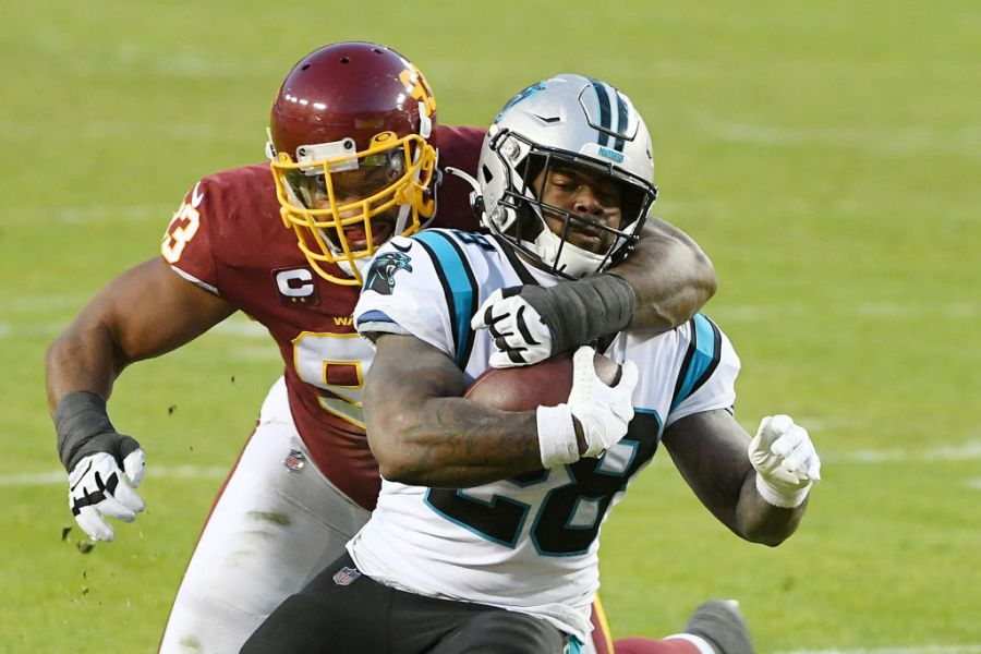 LANDOVER, MARYLAND - DECEMBER 27: Mike Davis #28 of the Carolina Panthers is tackled by Jonathan Allen #93 of the Washington Football Team at FedExField on December 27, 2020 in Landover, Maryland. (Photo by Will Newton/Getty Images)