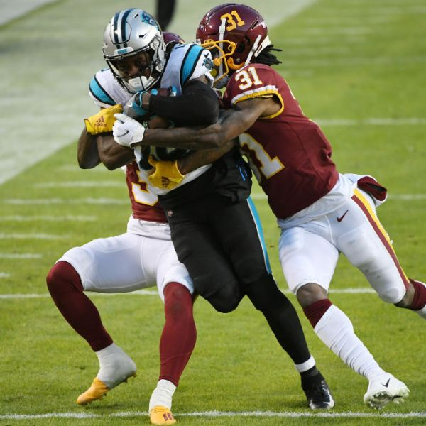 LANDOVER, MARYLAND - DECEMBER 27: Curtis Samuel #10 of the Carolina Panthers is tackled by Juston Burris #31 and Reggie Bonnafon #39 of the Carolina Panthers during the second quarter at FedExField on December 27, 2020 in Landover, Maryland. (Photo by Will Newton/Getty Images)