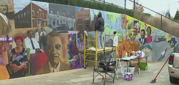 """Winston-Salem artist paints """"Depot Street Renaissance"""" mural"""