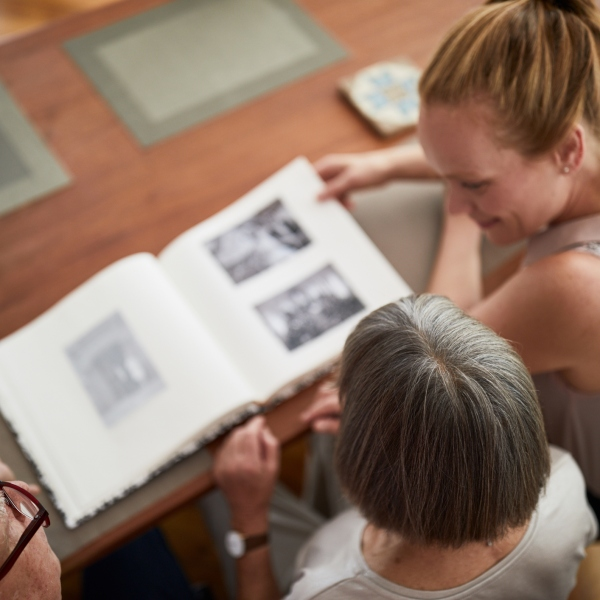 Family looking at photo album. (Getty Images)
