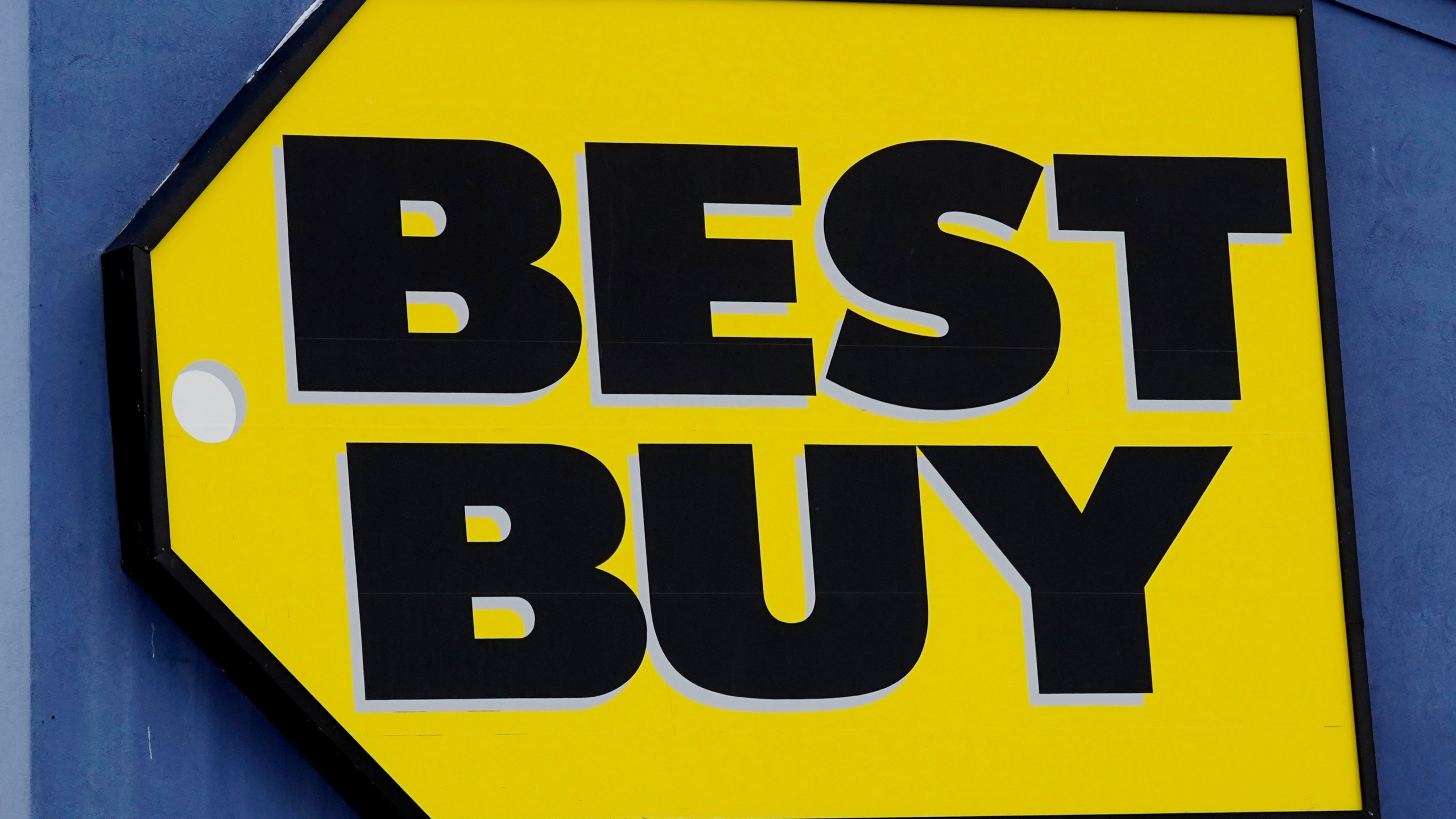 A Best Buy store sign is displayed in Arlington Heights, Ill., Saturday, Feb. 6, 2021. Best Buys is closing five stores in four states in the next month. The retailer plans to close two Richmond, Va., area stores, along with one store each in Syracuse, N.Y., Carbondale, Ill., and Brockton, Mass. (AP Photo/Nam Y. Huh)