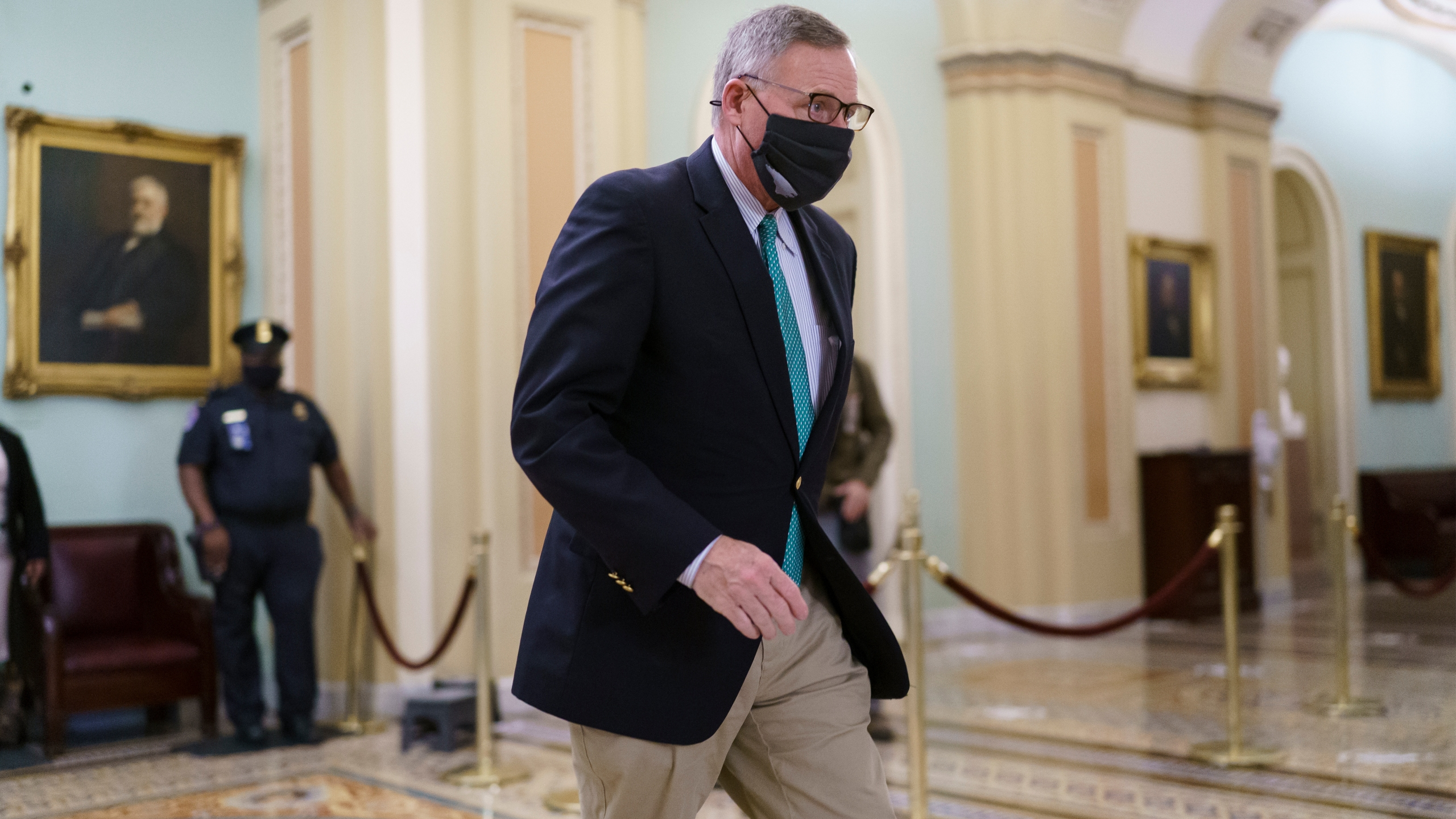 Sen. Richard Burr, R-N.C., leaves the chamber as the Senate voted to consider hearing from witnesses in the impeachment trial of former President Donald Trump, at the Capitol in Washington, Saturday, Feb. 13, 2021. (AP Photo/J. Scott Applewhite)