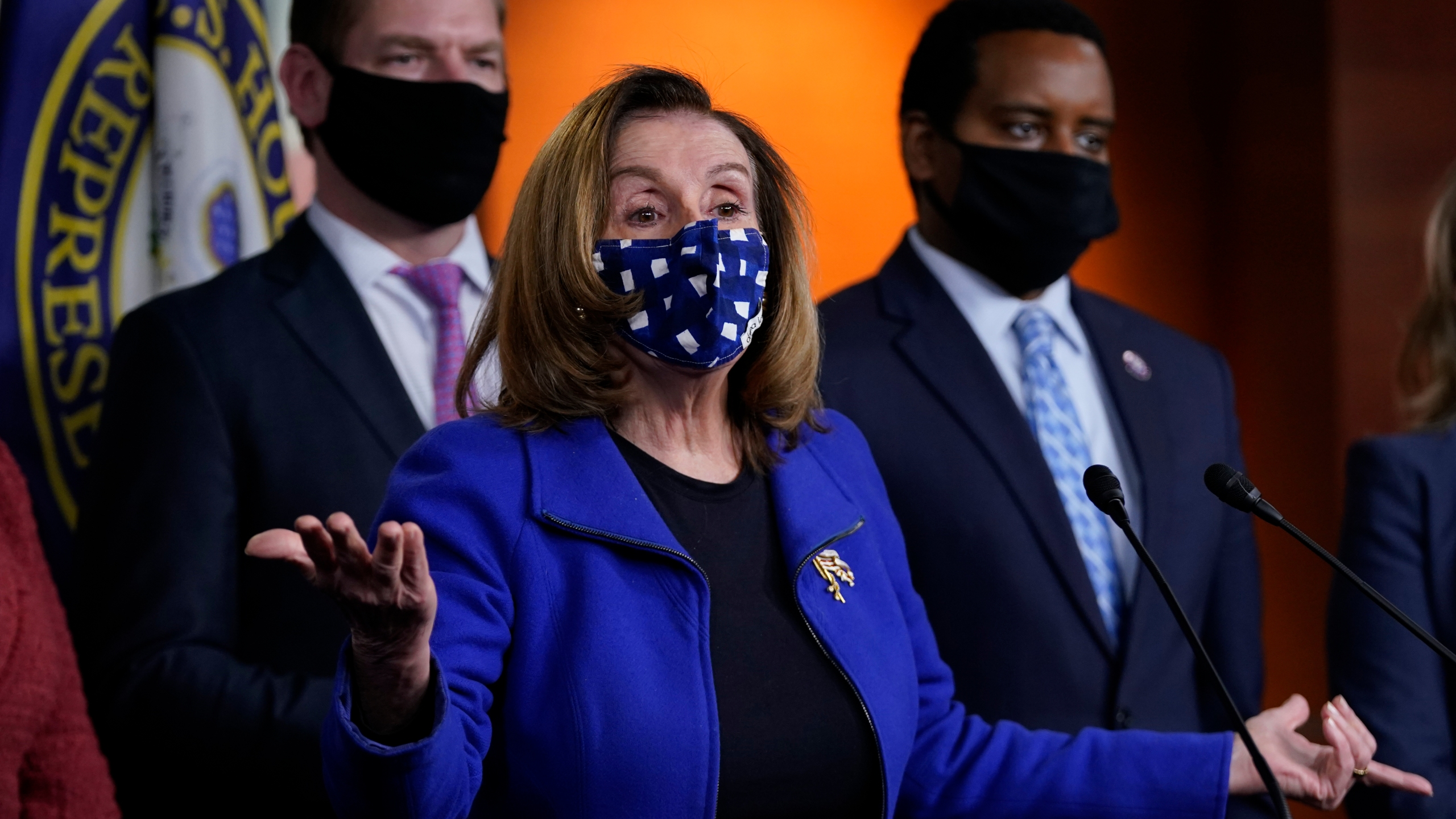 House Speaker Nancy Pelosi of Calif., with impeachment managers Rep. Eric Swalwell, D-Calif., and Rep. Joe Neguse, D-Colo., speaks to members of the media during a news conference on Capitol Hill in Washington, after the U.S. Senate voted not guilty, to acquit former President Donald Trump of inciting riot at U.S. Capitol, ending impeachment trial, Saturday, Feb. 13, 2021. (AP Photo/Manuel Balce Ceneta)