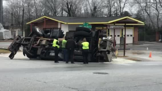 Salt truck overturns, dumps salt onto curb on Martin Luther King Jr. Drive in Greensboro