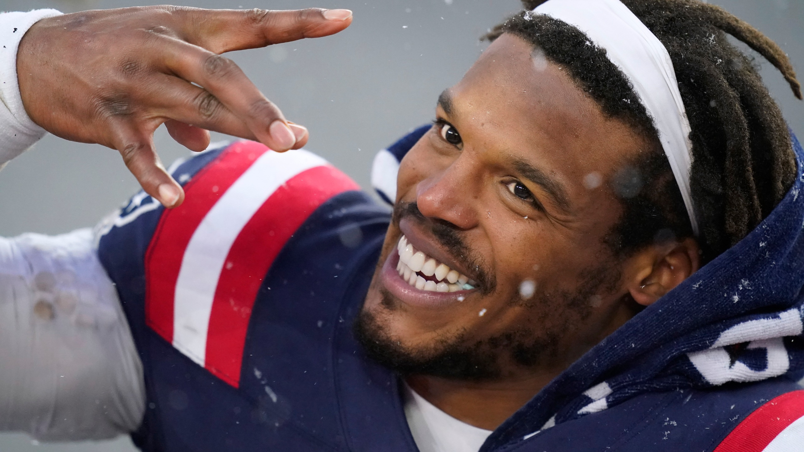 FILE - In this Jan. 3, 2021, file photo, New England Patriots quarterback Cam Newton leaves the field after an NFL football game against the New York Jets in Foxborough, Mass. The New England Patriots are completing an agreement to re-sign free-agent quarterback Cam Newton, a person with knowledge of the negotiations told The Associated Press, Friday, March 12, 2021. (AP Photo/Elise Amendola, File)
