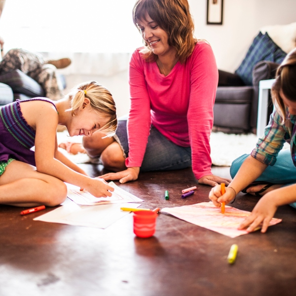 Family coloring with crayons (Getty Images)