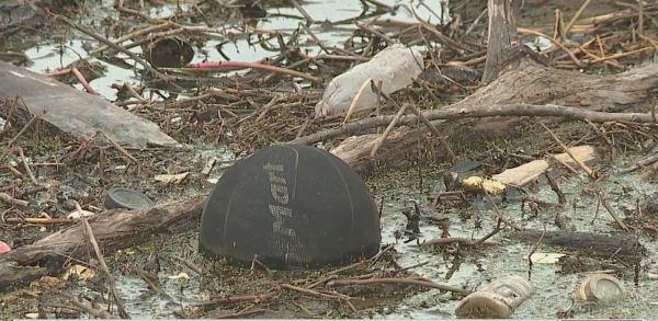 Neighbors want solutions to trash floating in Randleman Lake