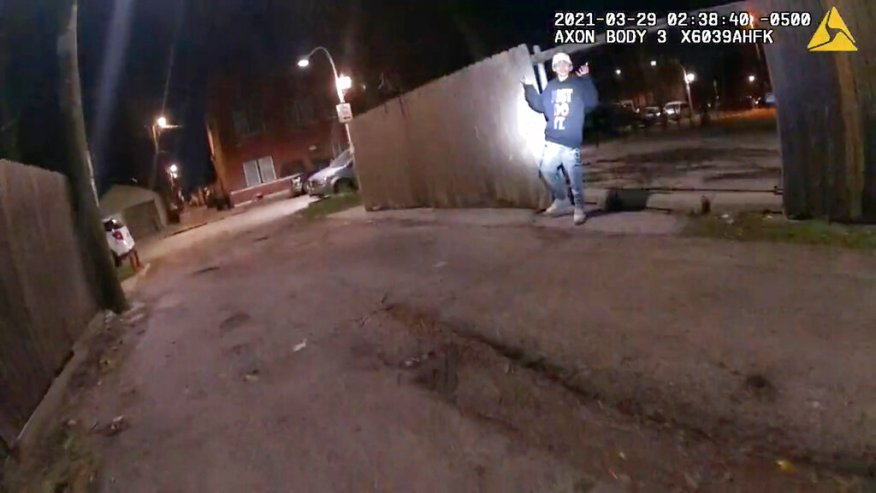 This image from Chicago Police Department body cam video shows the moment before Chicago Police officer Eric Stillman fatally shot Adam Toledo, 13, on March 29, 2021, in Chicago. (Chicago Police Department via AP)