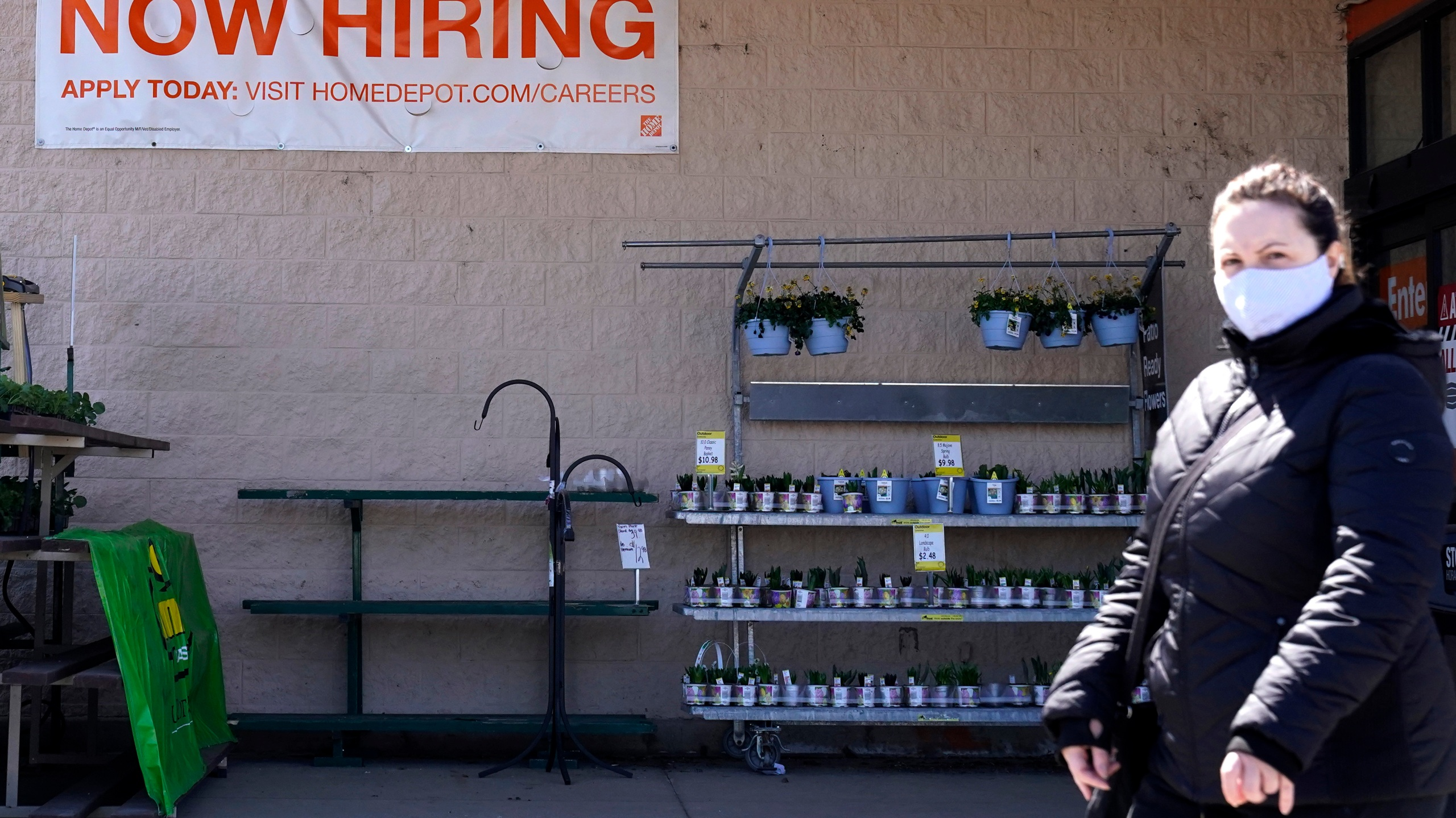 A hiring sign is seen outside home improvement store in Mount Prospect, Ill., Friday, April 2, 2021. America's employers unleashed a burst of hiring in March, adding 916,000 jobs in a sign that a sustained recovery from the pandemic recession is taking hold as vaccinations accelerate, stimulus checks flow through the economy and businesses increasingly reopen. (AP Photo/Nam Y. Huh)