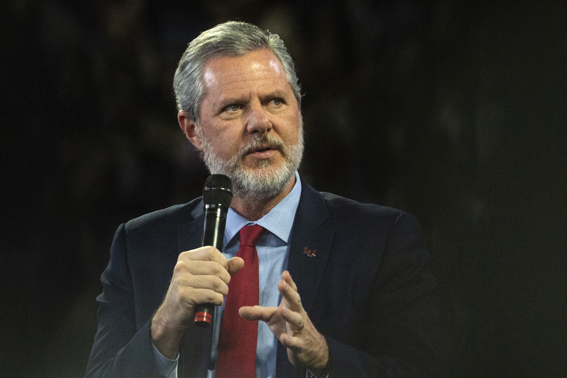 "FILE - In this, Nov. 13 2019, file photo, Liberty University President Jerry Falwell Jr. talks to Donald Trump Jr. about his new book ""Triggered"" during convocation at Liberty University in Lynchburg, Va. Liberty University has filed a civil lawsuit against its former leader, Jerry Falwell Jr., seeking millions in damages after the two parted ways acrimoniously last year. The Associated Press obtained the complaint, which was filed Thursday, April 15, 2021 in Lynchburg Circuit Court. (Emily Elconin/The News & Advance via AP, File)"