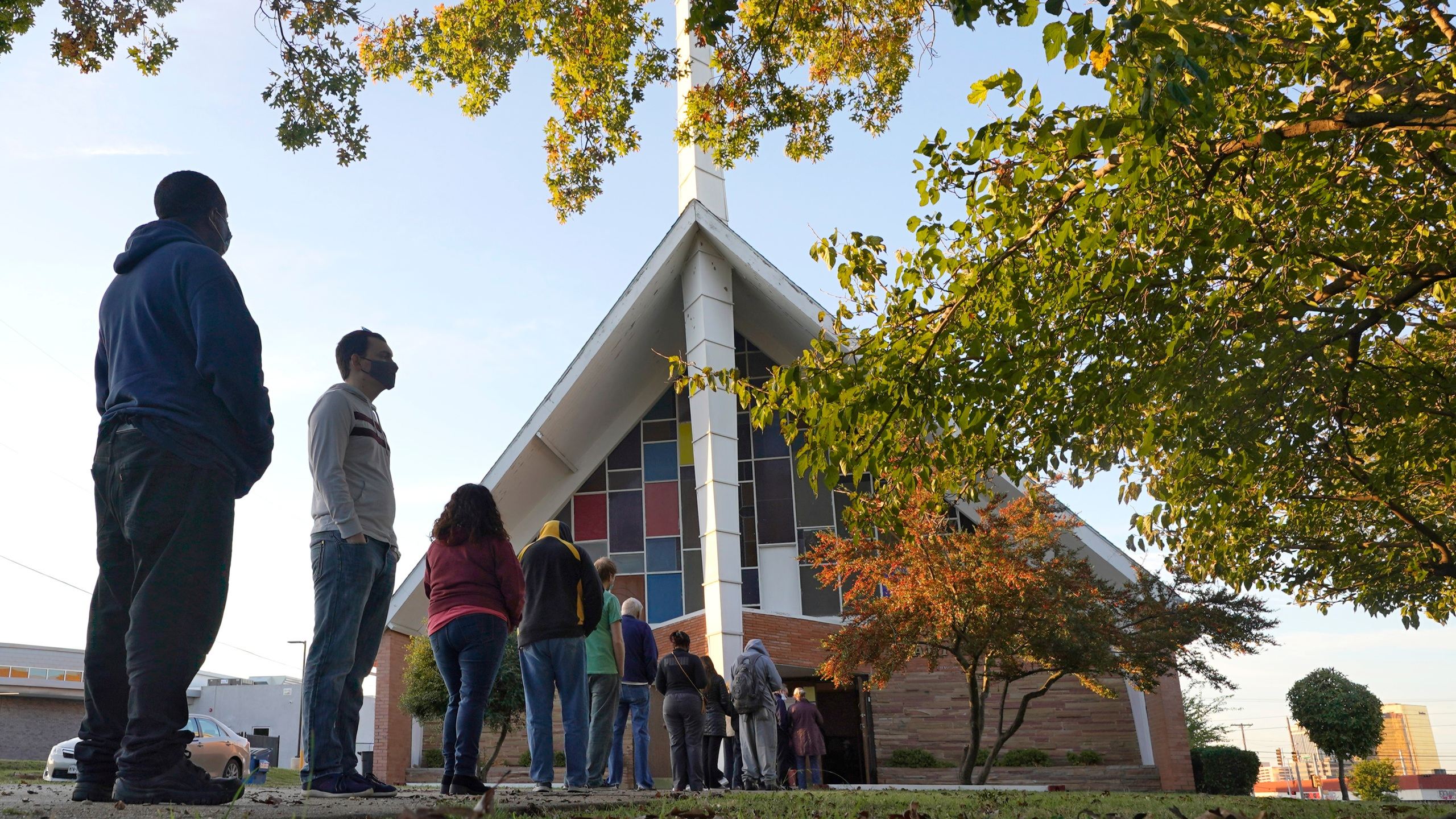 FILE - In this Tuesday, Nov. 3, 2020 file photo, Voters line up outside Vickery Baptist Church waiting to cast their ballots on Election Day in Dallas. In Georgia, faith leaders are asking corporate executives to condemn laws restricting voting access — or face a boycott. In Arizona and Texas, clergy have assembled outside the state capitols to decry what they view as voter-suppression measures targeting Black and Hispanic people. (AP Photo/LM Otero, File)