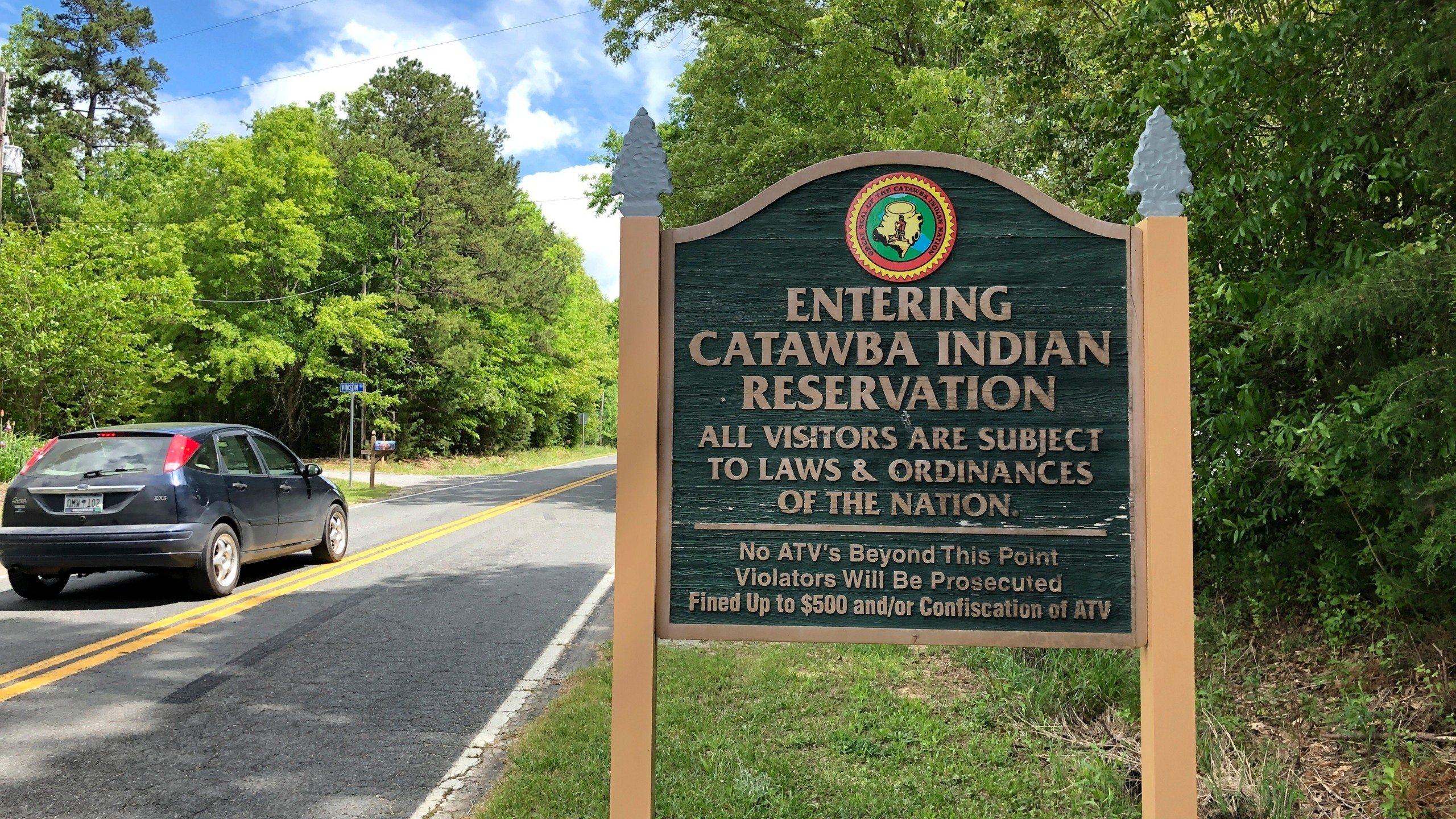 FILE - In this Friday, April 26, 2019 file photo, a sign welcomes people to the Catawba Indian Nation's reservation near Rock Hill, S.C. The South Carolina-based tribe has received federal and state approvals to build and run a casino near Kings Mountain, North Carolina. A federal judge on Friday rejected a legal challenge from Eastern Band of Cherokee Indians, which currently runs two casinos in the state. The land for the proposed casino is 35 miles (56 kilometers) northwest of the Catawba reservation in upstate South Carolina. (AP Photo /Jeffrey Collins, File)
