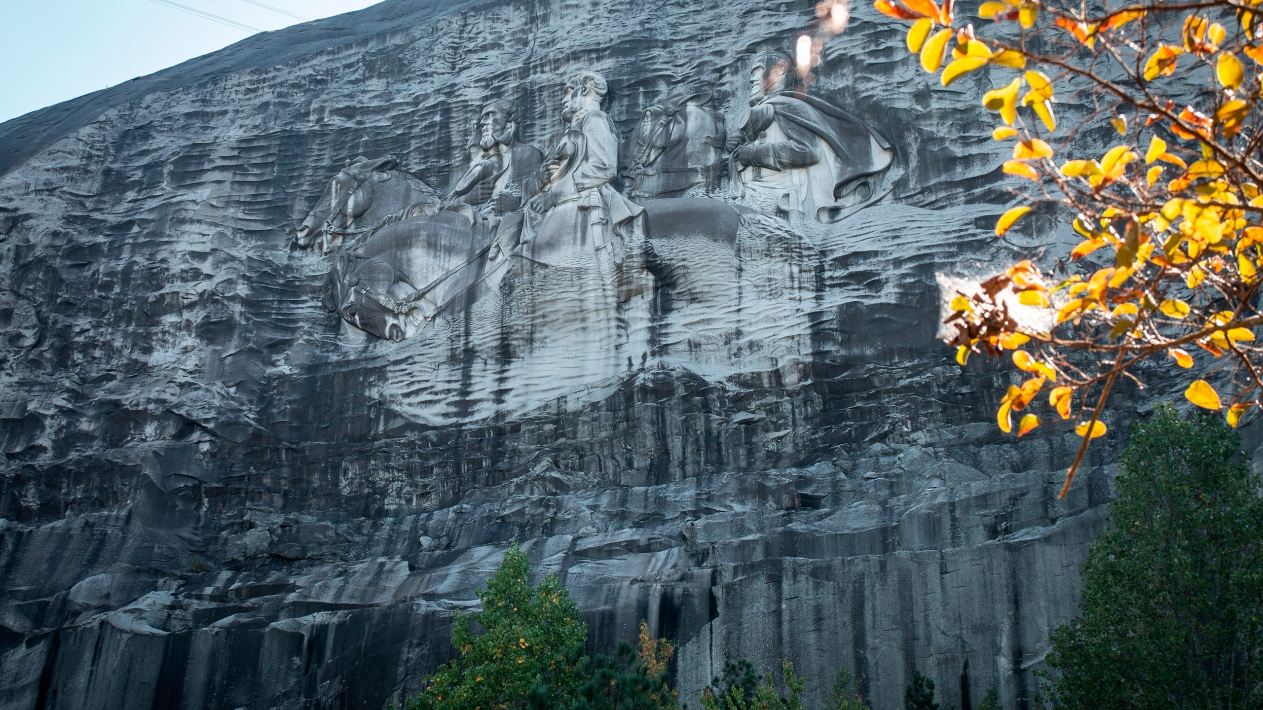 FILE- In this Oct. 5, 2020 file photo, a massive mountainside carving depicting Confederate leaders Jefferson Davis, Robert E. Lee and Stonewall Jackson is shown, in Stone Mountain, Ga. The board overseeing an Atlanta area park that has centuries-old ties to the Ku Klux Klan and contains the largest Confederate monument ever crafted will be headed for the first time by an African American, Rev. Abraham Mosley. (AP Photo/Ron Harris, File)