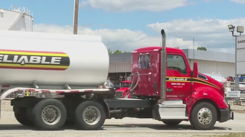 Tanker trucks delivering fuel to the pumps in the Triad