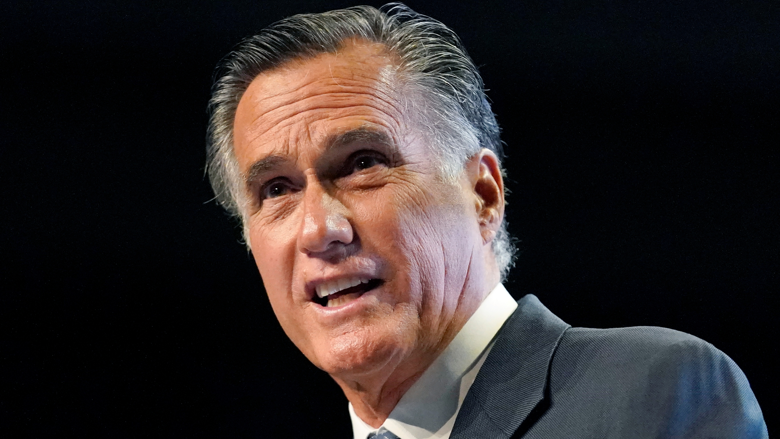 Sen. Mitt Romney addresses the Utah Republican Party 2021 Organizing Convention Saturday, May 1, 2021, in West Valley City, Utah. Romney was booed as he addressed the Utah GOP convention. (AP Photo/Rick Bowmer)