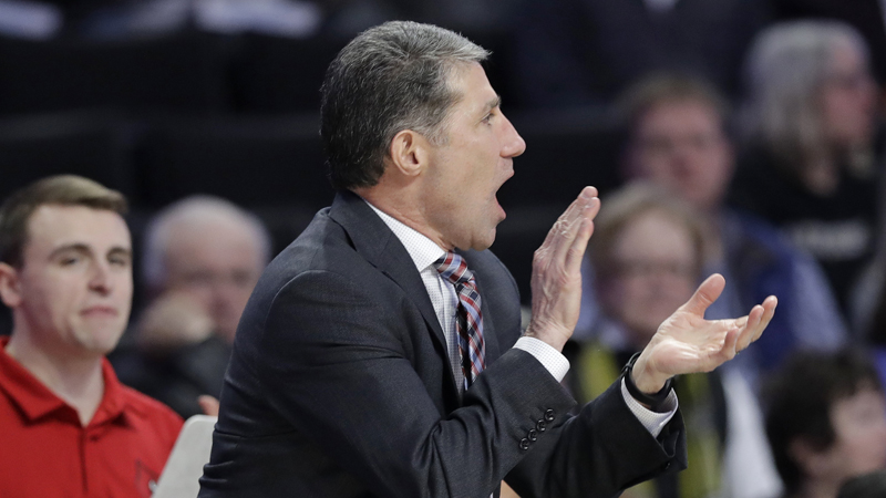 FILE - In this Jan. 30, 2019, file photo, Louisville assistant coach Dino Gaudio cheers on the team against Wake Forest during the second half of an NCAA college basketball game in Winston-Salem, N.C. Federal authorities have charged Gaudio with attempting to extort the university after his dismissal from the team. Gaudio threatened to go to the media with alleged NCAA violations by the team, according to a charging document filed in federal court. (AP Photo/Chuck Burton, File)