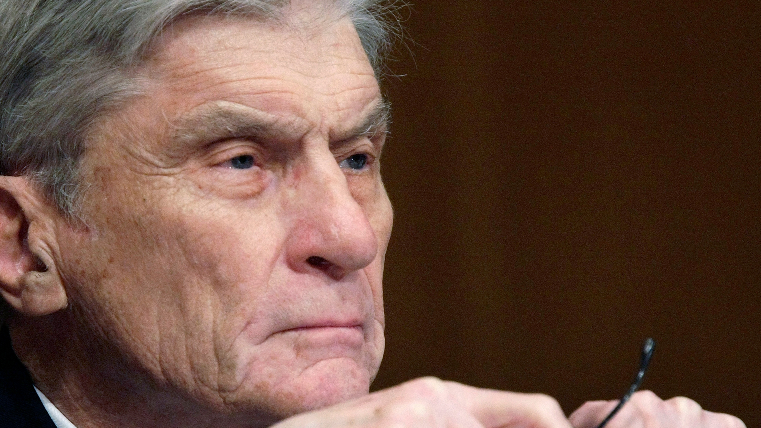 In this April 8, 2008 file photo, then Senate Armed Services Committee member Sen. John Warner, R-Va., listens to testimony on Capitol Hill in Washington. Warner, a former Navy secretary and one of the Senate's most influential military experts, has died at 94. (AP Photo/Pablo Martinez Monsivais, File)