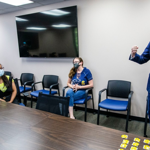 North Carolina Governor Roy Cooper talks with people who just received their COVID-19 vaccine at the Davidson County Health Department in Lexington, N.C., on Thursday, June 17, 2021. (Woody Marshall of the News & Record.)