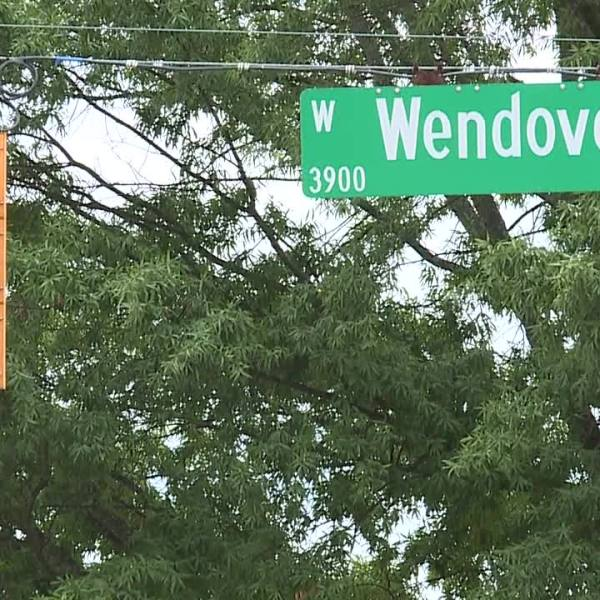 Greensboro police sergeant hit by van on Wendover Avenue, taken to hospital; driver faces multiple charges