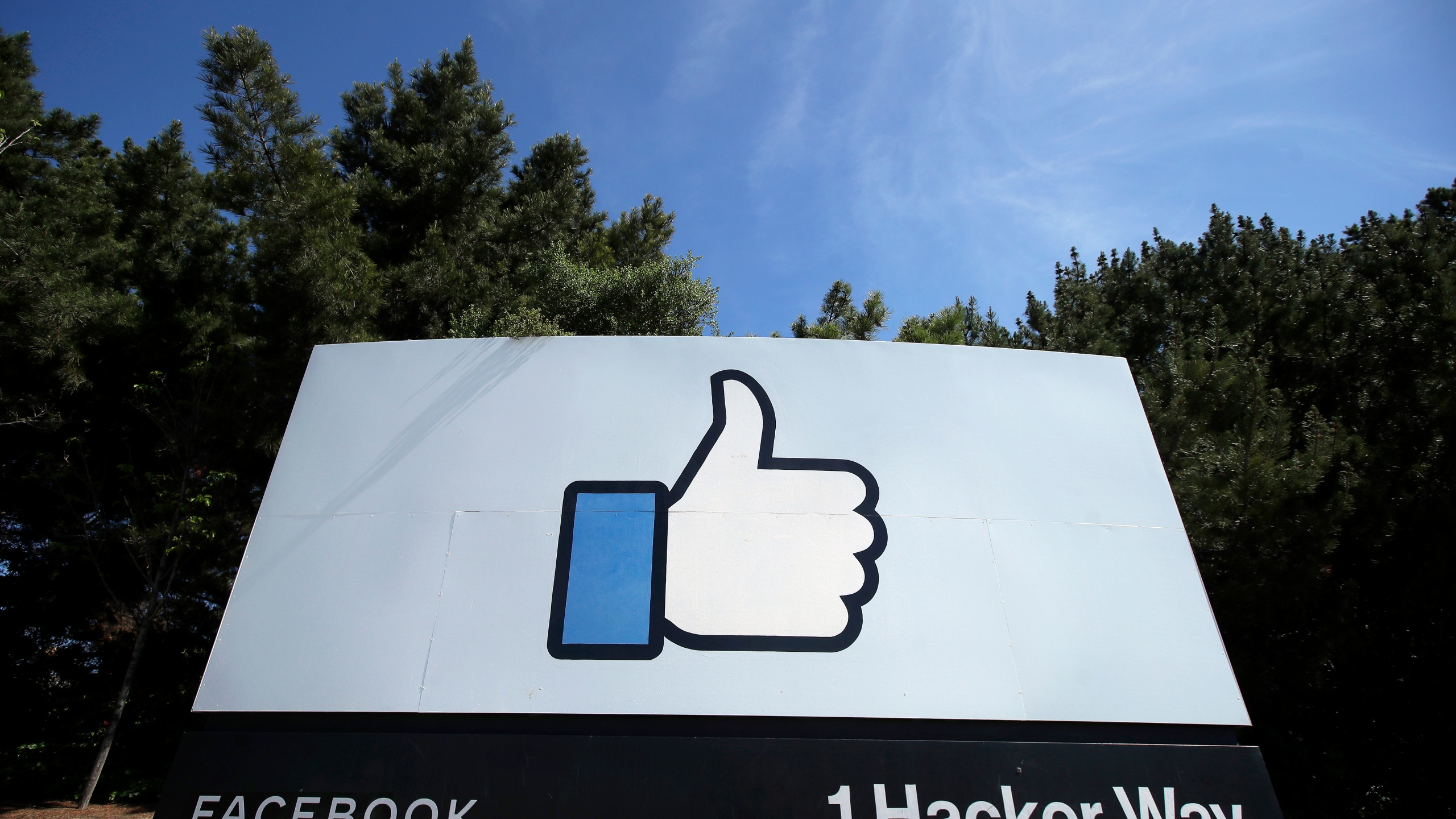 FILE - In this April 14, 2020 file photo, the thumbs up Like logo is shown on a sign at Facebook headquarters in Menlo Park, Calif. A federal judge has dismissed antitrust lawsuits brought against Facebook by the Federal Trade Commission and a coalition of state attorneys general, dealing a significant blow to attempts by regulators to rein in tech giants. (AP Photo/Jeff Chiu, File)