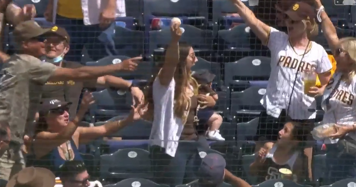 Mom holding baby snags foul ball with amazing one-handed grab