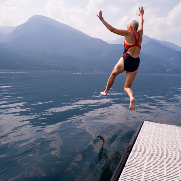 lady jumping into lake (getty)
