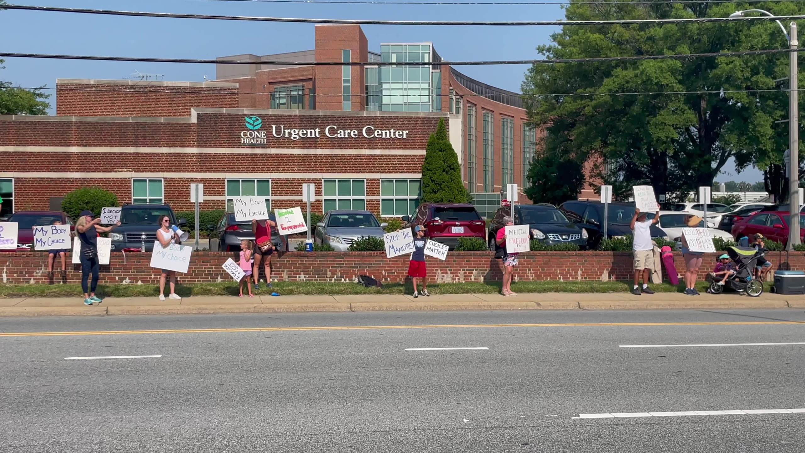 Protesters rally against Cone Health's COVID-19 vaccination requirement at Moses Cone Hospital in Greensboro