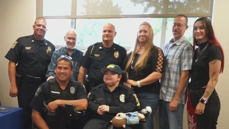 King teen with muscular dystrophy sworn in as honorary police officer