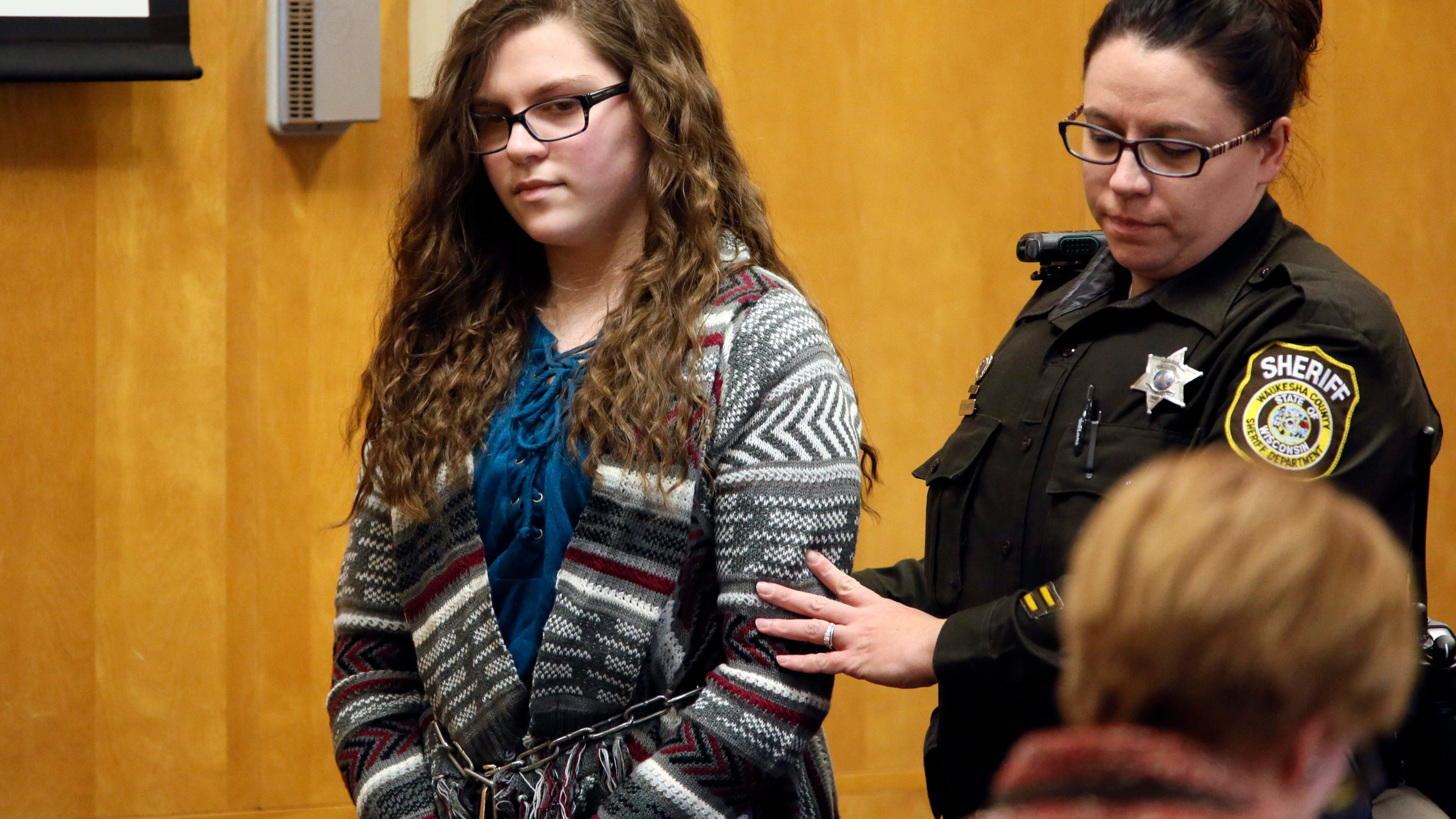 FILE - In this Dec. 21, 2017, file photo, Anissa Weier, one of two Wisconsin girls who tried to kill a classmate to win favor with a fictional horror character named Slender Man, is led into Court for her sentencing hearing, in Waukesha, Wis. A Wisconsin judge on Thursday, July 1, 2021, ordered her release after being convicted of the stabbing in 2014. Weier asked Waukesha County Judge Michael Bohren this year to release her from the Winnebago Mental Health Institute, arguing she was no longer a threat to anyone. (Michael Sears/Milwaukee Journal-Sentinel via AP, File)