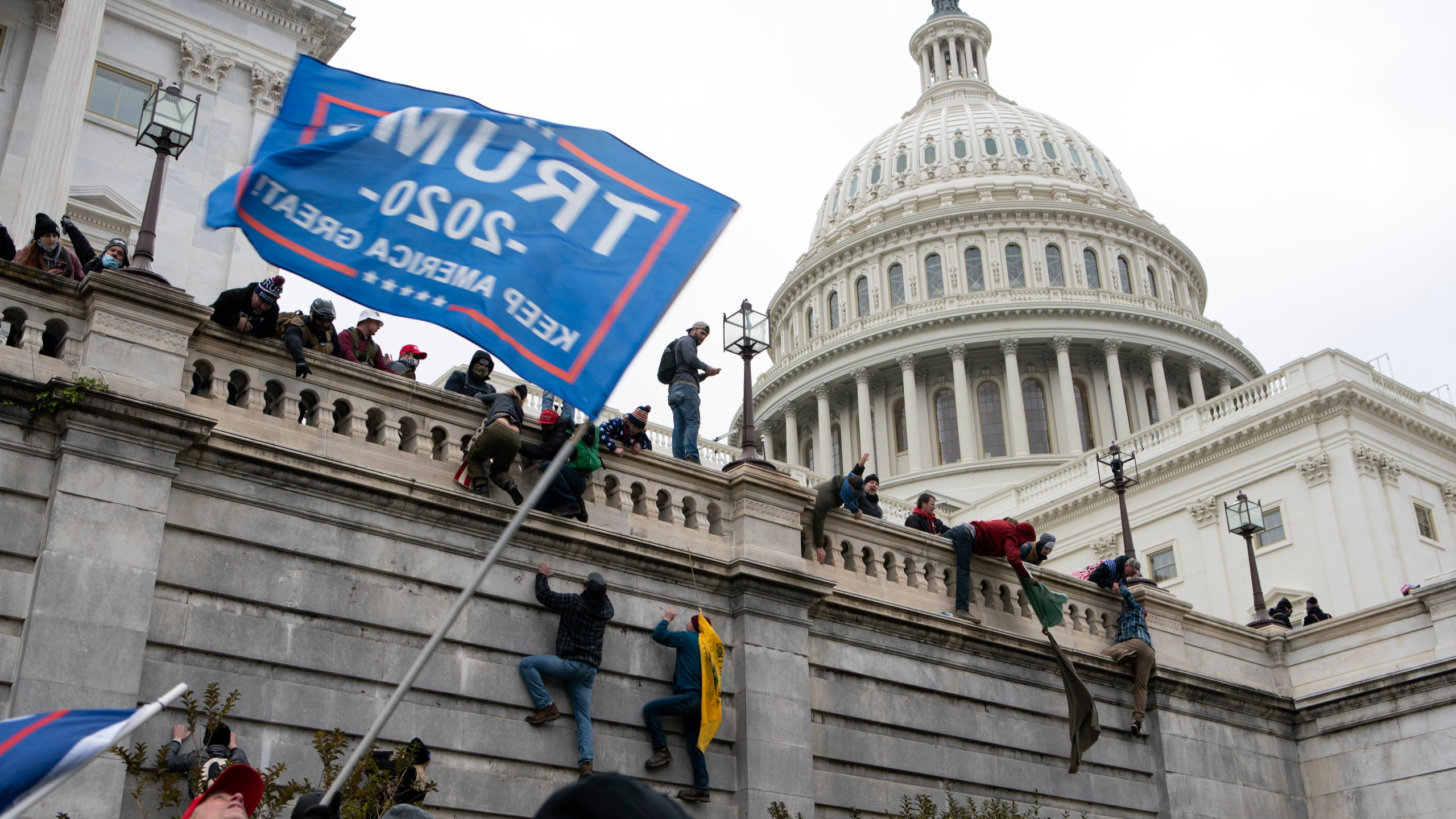 FILE - In this Jan. 6, 2021 file photo, violent insurrectionists loyal to President Donald Trump scale the west wall of the the U.S. Capitol in Washington. (AP Photo/Jose Luis Magana, File)