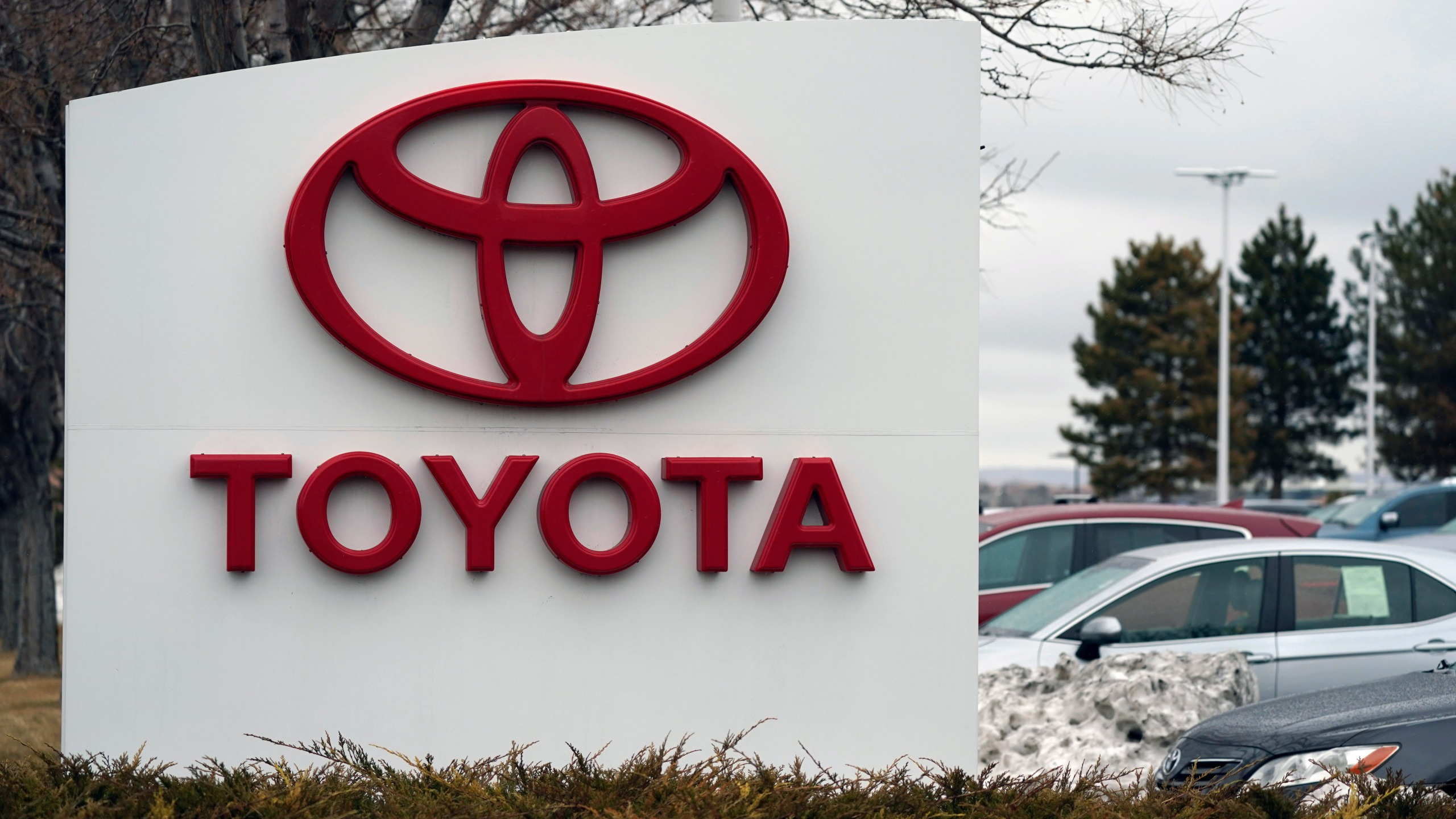 FILE - In this Sunday, March 21, 2021 file photo, The company logo adorns a sign outside a Toyota dealership in Lakewood, Colo. Toyota has reversed itself and says its political action committee will no longer contribute to legislators who voted against certifying Joe Biden's presidential election win. The move comes after a social media backlash over the contributions, with threats to stop buying Toyota vehicles. (AP Photo/David Zalubowski, File)