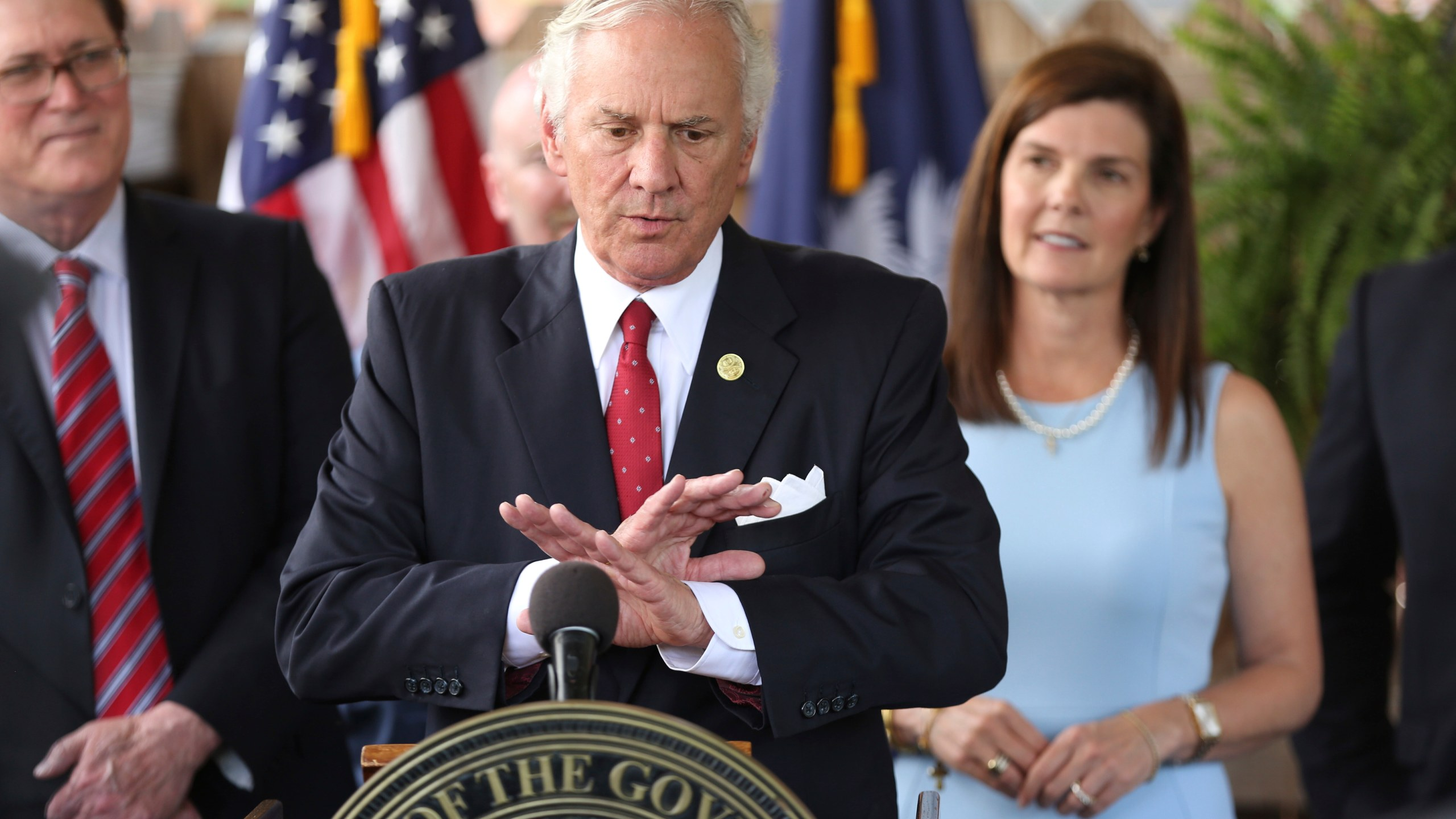 FILE - In this June 24, 2021, file photo, South Carolina Gov. Henry McMaster speaks during a ceremony to sign a bill preventing people from suing businesses over COVID-19 on Thursday, at Cafe Strudel in West Columbia, S.C. McMaster is one of several Republican state leaders opposing federal efforts to go door-to-door to urge people to get vaccinated against COVID-19. (AP Photo/Jeffrey Collins, File)