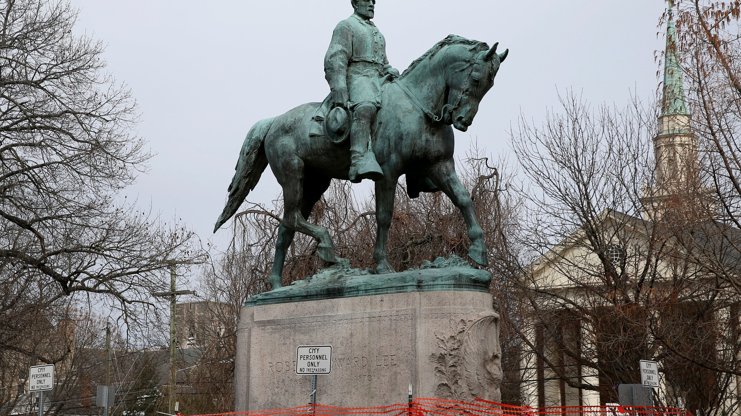 """FILE - The statue of Robert E. Lee is seen uncovered in Emancipation Park in Charlottesville, Va., on Wednesday, Feb. 28, 2018. Charlottesville said in a news release Friday, July 9, 2021, that the equestrian statue of Confederate Gen. Robert E. Lee as well as a nearby one of Confederate Gen. Thomas """"Stonewall"""" Jackson will be taken down Saturday. (Zack Wajsgras/The Daily Progress via AP)"""