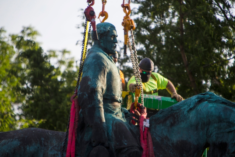Workers prepare to remove the monuments of Confederate General Robert E. Lee on Saturday, July 10, 2021 in Charlottesville, Va. The removal of the Lee statue follows years of contention, community anguish and legal fights. (AP Photo/John C. Clark)