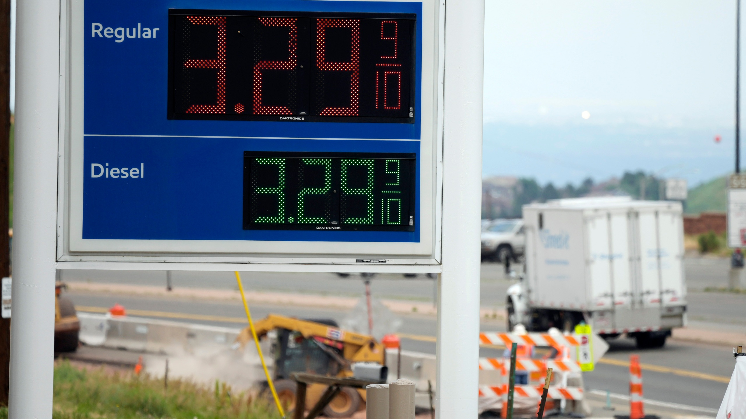 FILE - In this Thursday, July 1, 2021, file photo, the gasoline prices are displayed on a sign as motorists head east along a frontage road parallel to Interstate 70 to get an early start on the Fourth of July holiday weekend near Golden, Colo. Drivers are facing pricier fill-ups as more people hit the road for work, travel and other activities that the virus pandemic halted. (AP Photo/David Zalubowski, File)
