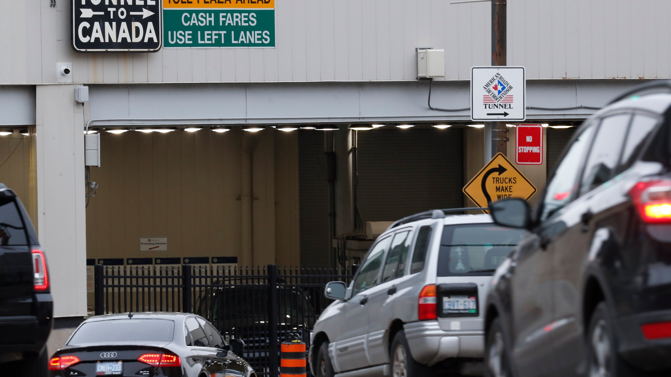 FILE - In this March 16, 2020, file photo, vehicles enter the Detroit-Windsor Tunnel in Detroit to travel to Canada. The Canada Border Services Agency has rejected a creative plan by Windsor Mayor Drew Dilkens to have Ontario residents line up inside the tunnel to get COVID-19 vaccinations. (AP Photo/Paul Sancya, File)
