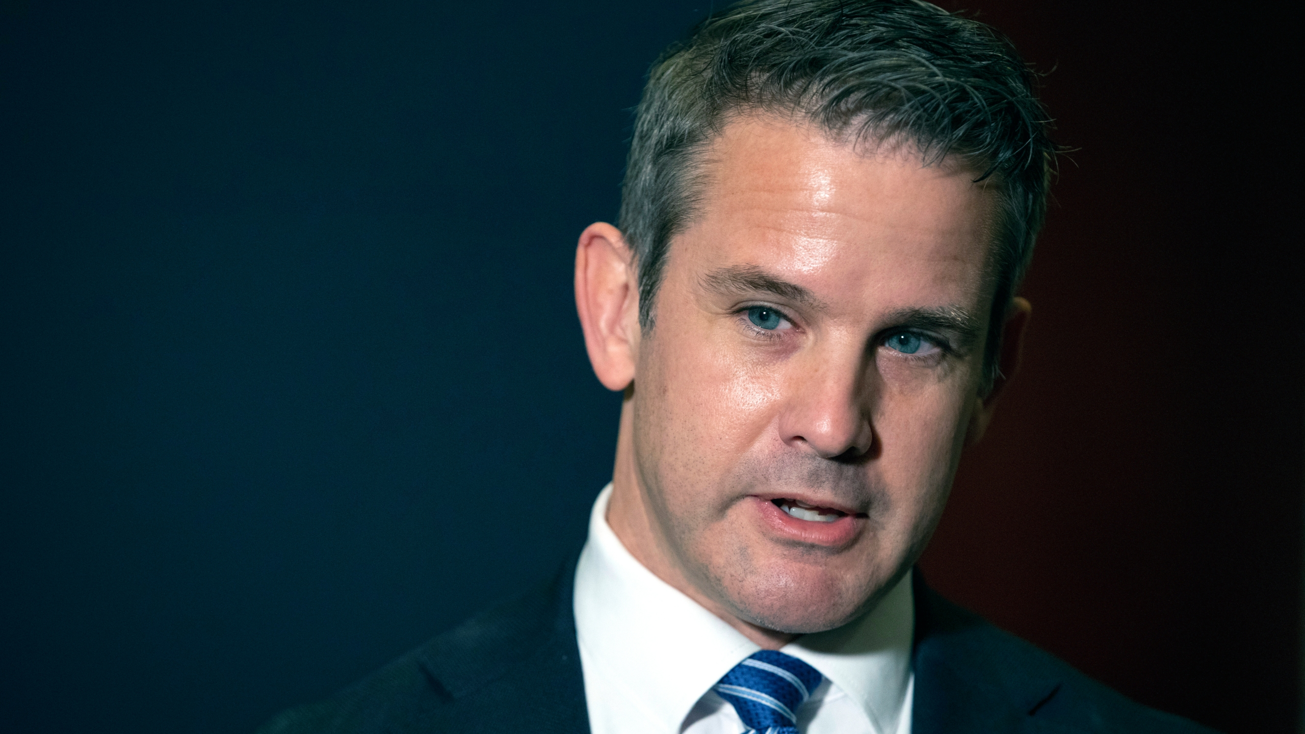 """FILE - In this May 12, 2021 file photo, Rep. Adam Kinzinger, R-Ill., speaks to the media at the Capitol in Washington. House Speaker Nancy Pelosi said Sunday, July 25 she intends to name Kinzinger to a congressional committee investigating the violent Jan. 6 Capitol insurrection, pledging that the panel will """"find the truth"""" even as the GOP threatens to boycott the effort. (AP Photo/Amanda Andrade-Rhoades, File)"""