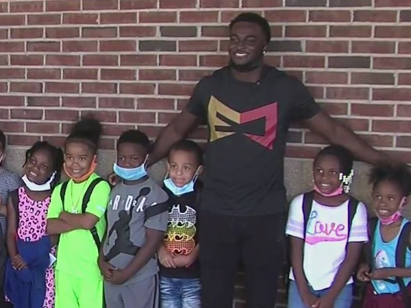 NFL player Emmanuel Moseley, who starred at Dudley High, hands out backpacks and school supplies in Greensboro
